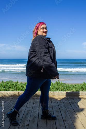 Fotografie, Tablou Plus size model walking on the beach, fat woman