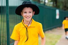 Aussie School Boy With A Hat Outside