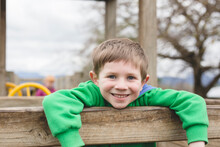 Young Boy On Playground Smiling At The Camera