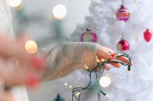 Woman Preparing To Decorate Christmas Tree