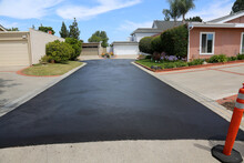 Private Drive Way, Street Rehabilitation And Slurry Seal Project Finished With Crews Expertly Applying The Slurry Seal. Re-surfaced Cul-de-sac Or Driveway.