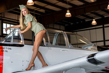 Lovely Blonde Model Posing With A Vintage World War II T-34 Trainer