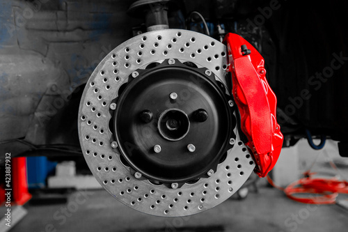 Car braking system red caliper and disc