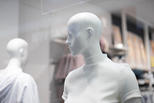 Female Bald Mannequins In White Sweaters In The Store, Close-up. Selective Focus