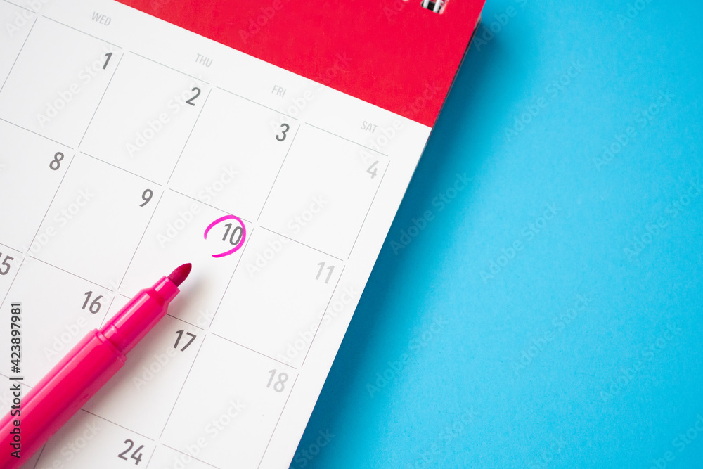 Fototapeta important appointment schedule write on white calendar page date on blue background