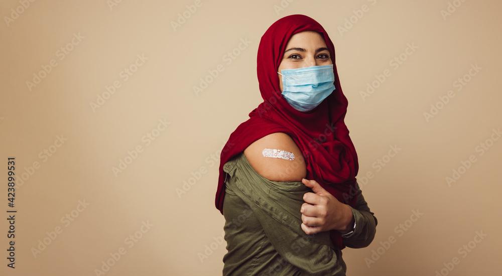 Fototapeta Muslim woman in hijab received a vaccine