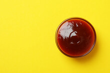 Bowl Of Barbecue Sauce On Yellow Background