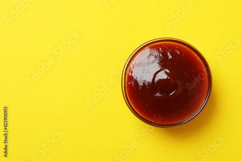 Fototapeta Bowl of barbecue sauce on yellow background obraz