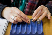 A Woman Counting Coins In A Shop, Close Up Hands And Coins