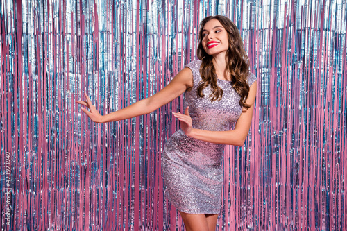 Fototapeta Portrait of attractive cheerful wavy-haired girl clubber dancing having fun isolated over glossy tinsel colorful background obraz na płótnie