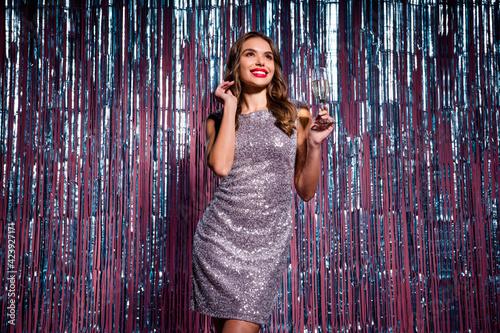 Fototapeta Photo of sweet shiny young lady wear glamour dress drink wine celebrating new eyear isolated glitter curtain background obraz na płótnie