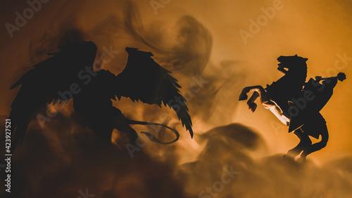 Photo Pojedynek rycerza na koniu z gryfem