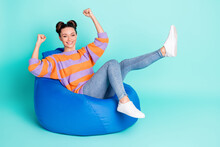 Full Length Profile Photo Of Pretty Cheerful Person Fists Up Raise Legs Celebrate Isolated On Blue Color Background