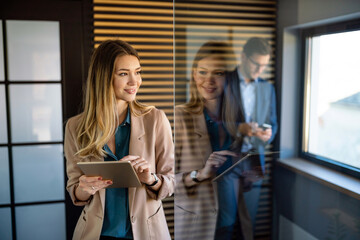 Professional business woman working with tablet in office