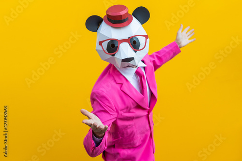 Leinwand Poster Man with funny low poly mask on colored background