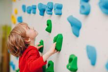 Kid Child Boy At Climbing Wall. Children Sport, Healthy Lifestyle In Kindergarten Or Sport Center In School