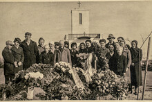 Latvia - CIRCA 1930s: People At Funeral Ceremony. Group Photo In Cemetery. Vintage Archive Art Deco Era Photo
