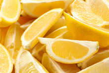 Many Fresh Juicy Lemon Slices As Background, Closeup
