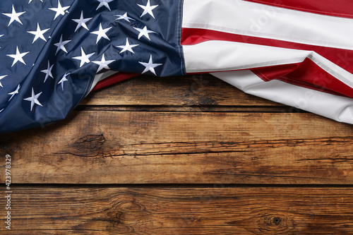 American flag on wooden table, top view with space for text. Memorial Day - fototapety na wymiar