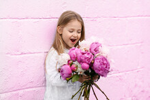 Portrait Of A Little Girl With The Peonies