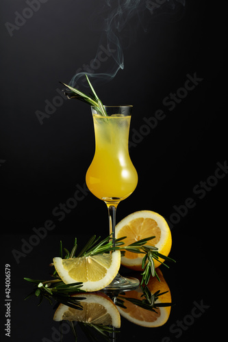 Obraz Traditional homemade lemon liqueur limoncello on the black background. - fototapety do salonu