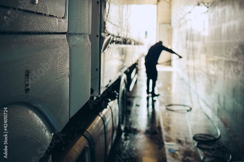 Stampa su Tela Big truck washing and cleaning at automatic car wash service or station
