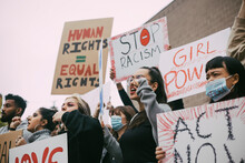 Male And Female Activists Protesting For Human Rights In Social Movement