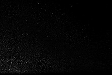 Black White Background From Drops Of Water And Ice. It Looks Like The Glowing Stars Of The Universe. Defocus. . High Quality Photo