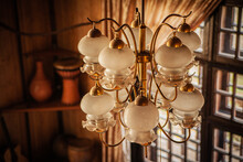 Large Golden Chandelier With A Large Number Of Lamps