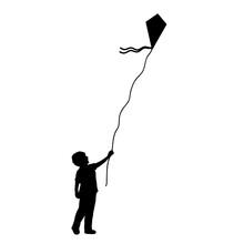 Silhouette Little Boy Flying Kite.