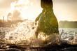 canvas print picture - Reitpferd planscht im See