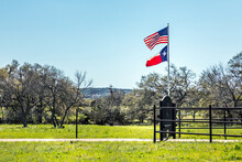 USA Flag And The Texas Flag Waving Together In The Hill Country