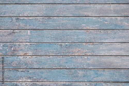 Textura de madera celeste, verde y amarilla. Líneas horizontales de madera antigua. Indie textura