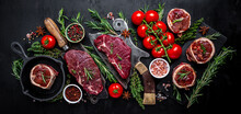 Variety Of Raw Black Angus Prime Meat Steaks Beef Rump Steak, Tenderloin Fillet Mignon Or Grilling With Seasoning On Black Background. Banner, Menu Recipe Top View