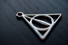 Close Up Silver Necklace Focus Deathly Hallows.