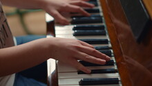 Close Up Of Unidentified Hands Playing Piano Indoors. Pianist Hands Practicing.