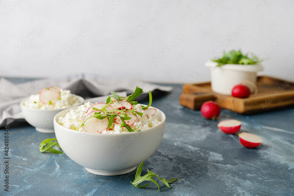 Fototapeta Bowls with cottage cheese on color background