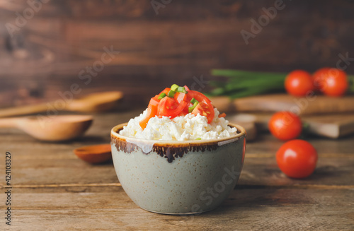 Foto Bowl with cottage cheese on wooden background