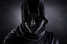 Portrait Of A Scary Figure In Hooded Cloak