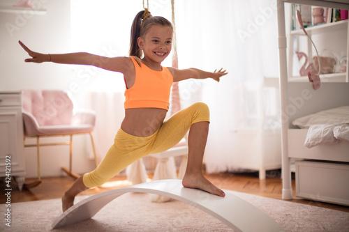 Obraz Little girl training at home. - fototapety do salonu