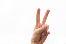 A Hand Doing Number Two Gesture On Blue Background. Gesturing Number 2. Peace Or Victory Symbol. Number Two Letter V In Sign Language. Being Second Concept. Hand Counting Two. Space For Ad Text.