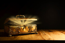 Image Of Mysterious Magical Treasure Chest With Light Over Wooden Old Table And Dark Background