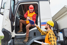 Truck Driver Brings Delivery To Construction Site With Worker
