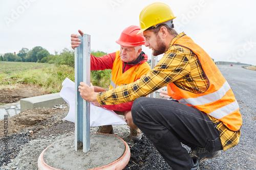 Obraz Construction workers check construction on construction site - fototapety do salonu