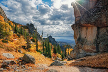 In The Canyon Of Rock Remains Among The Autumn Forest And The Sun's Rays On Mount Sinyukha In Kolyvan Altai