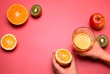 Fruits And Fresh Juice On The Pink Background. Orange, Lemon, Kiwi, Apple. Free Space For Text.