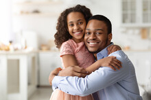 Loving Black Family Father And Daughter Hugging