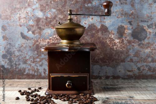 Fototapeta Still Life of a manual, wooden coffee bean grinder