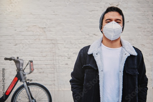 Tablou Canvas Young male in mask on city street