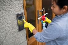 Female Cleaner Ringing Intercom